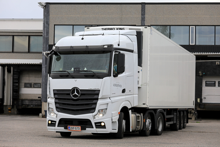 SALO, FINLAND - JUNE 18, 2017: White Mercedes-Benz Actros 2548 semi regfrigerated trailer of Kovanen Logistics Oy on the loading zone of a warehouse. Editorial