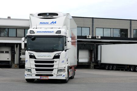 SALO, FINLAND - JUNE 18, 2017: White Next Generation Scania R580 truck regfrigerated trailer of Makela Oy on the loading zone of a warehouse.