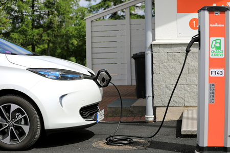 FORSSA, FINLAND - JUNE 23, 2017: White Renault Zoe ZE 40 Electric car is charging battery. The 5 door hatchback ZE 40 has a battery of 41 kWh.