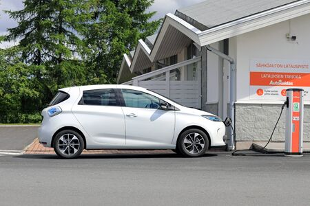 FORSSA, FINLAND - JUNE 23, 2017: White Renault Zoe ZE 40 Electric car is charging battery at service station. The 5 door hatchback ZE 40 has a battery of 41 kWh.
