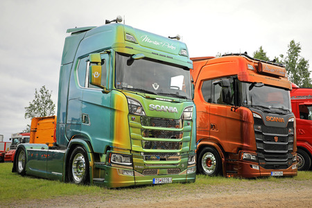 LOVIISA, FINLAND - JULY 1, 2017: Two beautifully customized Next Generation Scania S580 super trucks of Martin Pakos on display on Riverside Truck Meeting, Finland.