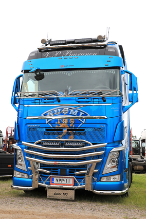 LOVIISA, FINLAND - JULY 1, 2017: Blue Volvo FH500 truck of Kuljetus V-P Puurunen with the theme of Finland 100 years on display on Riverside Truck Meeting 2017.
