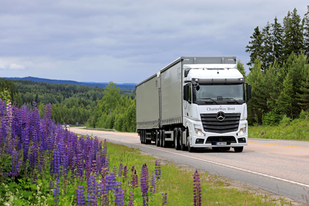 JAMSA, FINLAND - JULY 6, 2017: White Mercedes-Benz Actros 2551 cargo truck transports goods along scenic highway in Central Finland at summer. 에디토리얼