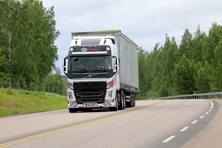 moving truck: ORIVESI, FINLAND - JULY 6, 2017: Customized white Volvo FH semi truck of HCO Logistics transports goods along highway in Central Finland at summer.