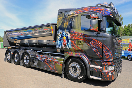 heavy: HAMEENLINNA, FINLAND - JULY 15, 2017: Beautifully customized Scania Golden Eagle tipper truck on display on Tawastia Truck Weekend 2017. Editorial