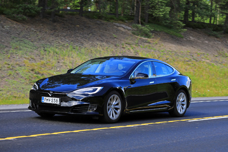 shiny car: NUMMELA, FINLAND - JULY 21, 2017: Black Tesla Model S luxury sedan with the new look on summer highway in South of Finland.