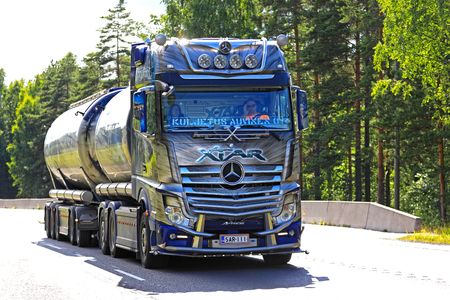 NUMMELA, FINLAND - JULY 21, 2017: Beautifully customized Mercedes-Benz Actros Show Truck Xtar for bulk transport of Kuljetus Auvinen Oy hauls goods along highway at summer in South of Finland.