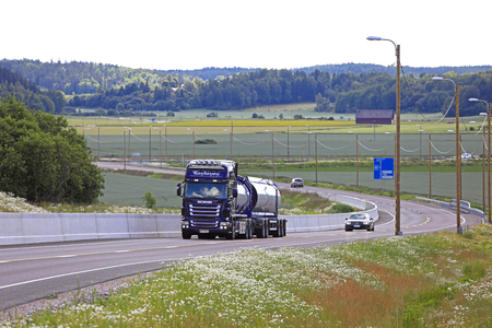 SALO, FINLAND - July 22, 2017: Purple Scania R500 tank truck for bulk transport of JR-Trans delivers goods along highway in the summer scenery of South of Finland. Editorial
