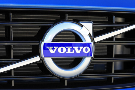 TURKU, FINLAND - JULY 29, 2017: Sign Volvo on the grille of a new blue car. Carmaker Volvo announces that all their new cars launched from 2019 onwards will be partially or completely battery-powered. Stock fotó - 83202250