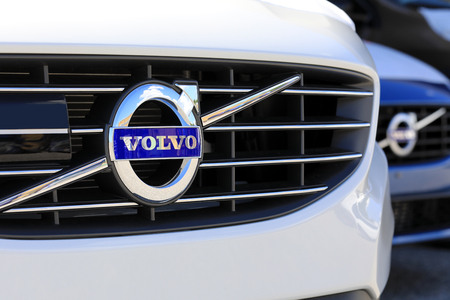 TURKU, FINLAND - JULY 29, 2017: Sign Volvo on the grille of a new white car. Carmaker Volvo announces that all their new cars launched from 2019 onwards will be partially or completely battery-powered.