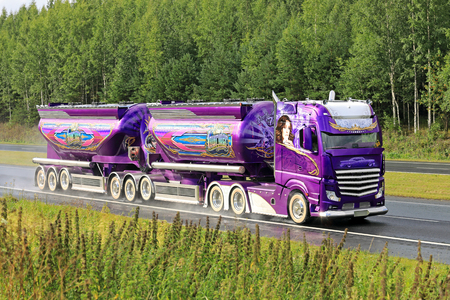 HATTULA, FINLAND - AUGUST 13, 2017: New Super truck Mercedes-Benz Actros Lowrider of Kuljetus Auvinen trucking along freeway after the award-winning premiere in Power Truck Show 2017.