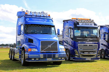 light duty: ALAHARMA, FINLAND - AUGUST 11, 2017: Blue conventional Volvo NH12 of Thoden Oy and cab over FH750 of JA Akeri AB trucks on display on Power Truck Show 2107.