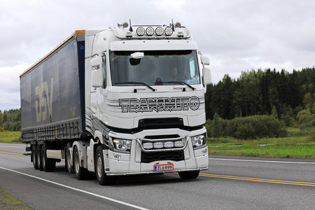 light duty: FORSSA, FINLAND - SEPTEMBER 15, 2017: Customized white Renault trucks T semi of Transmito hauls goods along highway on an overcast day in South of Finland.