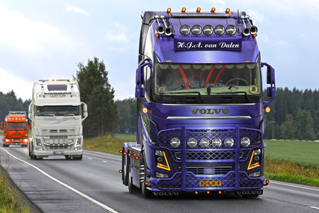 light duty: LUOPAJARVI, FINLAND - AUGUST 10, 2017: Beautifully customized Volvo FH FH16 750 of H.J.A. Van Dalen moves along road in truck convoy to Power Truck Show 2017 in Alaharma, Finland. Editorial