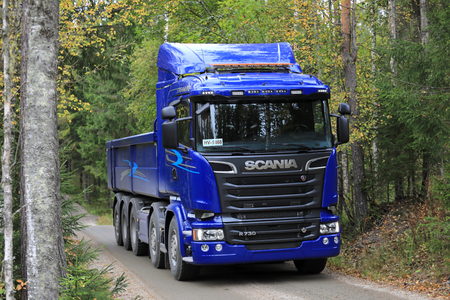 LAUKAA, FINLAND - SEPTEMBER 22, 2017: Blue Scania R730 truck for construction on a test drive on forest road during Scania Laukaa Tupaswilla Off-Road event.