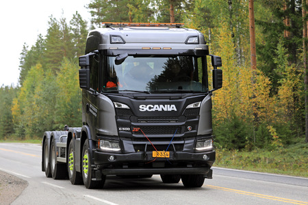 LAUKAA, FINLAND - SEPTEMBER 22, 2017: Next Generation Scania G500 XT 8X4 truck on a test drive along autumnal highway during Scania Laukaa Tupaswilla Off-Road event.