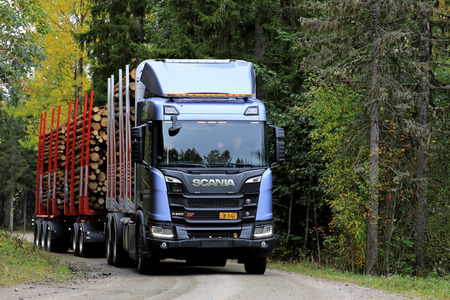 LAUKAA, FINLAND - SEPTEMBER 22, 2017: Scania R650 XT logging truck on a test drive along forest road during Scania Laukaa Tupaswilla Off-Road event.