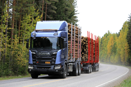 LAUKAA, FINLAND - SEPTEMBER 22, 2017: Scania R650 XT logging truck on a test drive along a main road during Scania Laukaa Tupaswilla Off-Road event. Editorial
