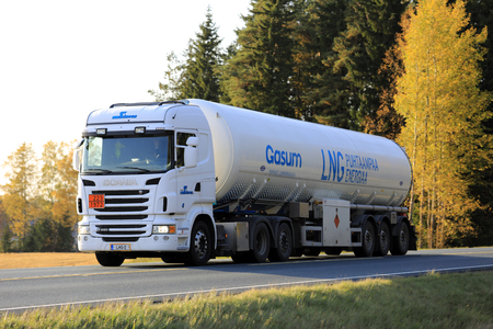 HUMPPILA, FINLAND - SEPTEMBER 29, 2017: White Scania R480 semi tank truck of Simeon hauls Gasum Liquified Natural Gas at sunset time in autumn. LNG is predominantly methane.