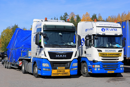 SALO, FINLAND - OCTOBER 15, 2017: MAN TGX 18.440 and Scania R450 semi trucks of De Lange Speciaaltransport stop in Salo while transporting oversize loads from Netherlands to Turku, Finland.