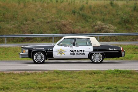 PAIMIO, FINLAND - AUGUST 26, 2016: Classic Cadillac Police car of Arizona Route 66 Sheriff along freeway in South of Finland.