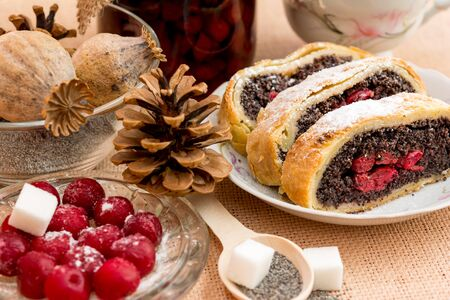 Poppy seed strudel with cherry on the sacking