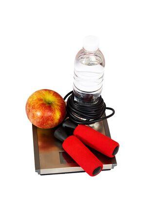 appel water: Springtouw, appel, water op de schaal. Sport en gezondheid