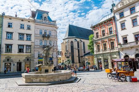 Lviv, Ukraine - August 3, 2015: The corner of Rynok Square and view of Latin Cathedral