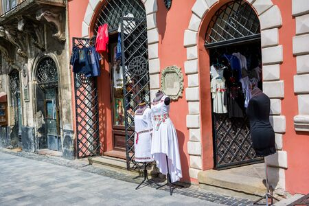 needlecraft product: Lviv, Ukraine - August 3, 2015: The corner of Rynok Square and view of national cloth shop