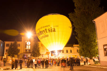 sity: Kamyanets-Podilskyi, Ukraine - May 15, 2015: Night show of glow balloons at the festival Towards the sun on the old sity square