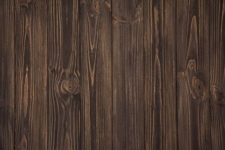 brown wallpaper: Dark brown vintage wooden old planks background Stock Photo