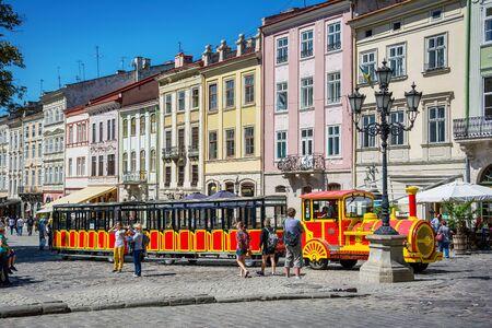 lemberg: Lviv, Ukraine - August 3, 2015: Lviv city center. Market square. Sightseeing tour train.