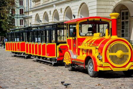 sightseeing tour: Lviv, Ukraine - August 3, 2015: Lviv city center. Market square. Sightseeing tour train.