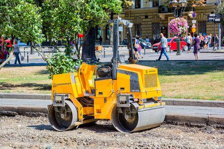lemberg: Lviv, Ukraine - August 19, 2015: Road roller machine at ancient historical center of Lviv