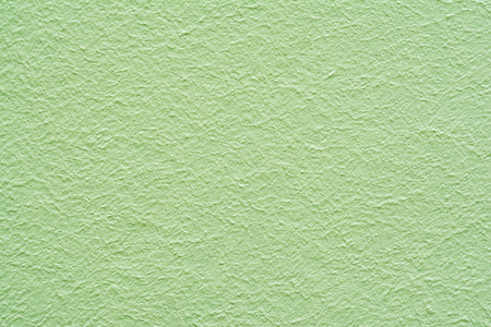 light green wall: Abstract light green wall plastered texture. Rustic background Stock Photo