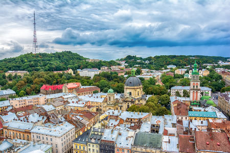 Lviv, Ukraine old city vintage toned top view panorama with houses roofs. High Castle park, Dominican Church, Korniakt Tower, Dormition Assumption church, television tower Stock Photo