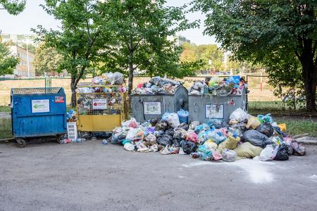 Lviv, Ukraine - September 13, 2016: Dumpsters being full with garbage Editorial