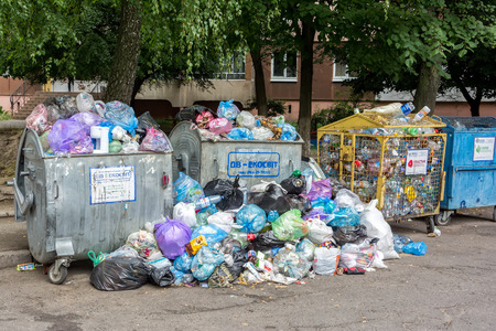 disposed: Lviv, Ukraine - September 13, 2016: Dumpsters being full with garbage Editorial