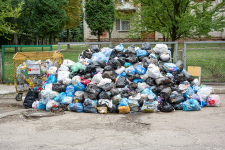 big bin: Lviv, Ukraine - September 13, 2016: Dumpsters being full with garbage Editorial