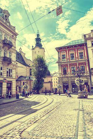 lemberg: Lviv, Ukraine - August 15, 2016: Historic center of Lviv on the corner of Market Square near Latin Cathedral. Vintage toned