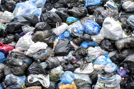 disposed: Dumpsters being full with heap of garbage overflowing