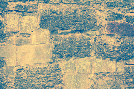 Old stone bricks wall texture background. Vintage toned