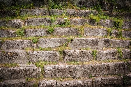 Old stone bricks wall texture background. Vintage dark toned