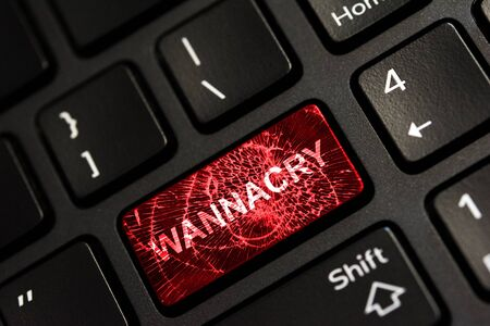 Message on broken red enter key of keyboard. Computer wannacry virus attack. Copy space