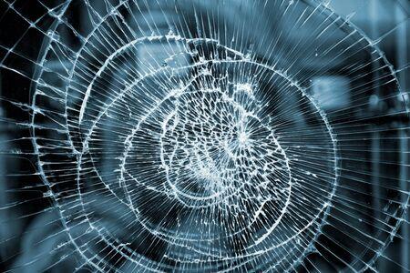 art piece: Broken glass abstract pattern. Damaged window closeup background Stock Photo