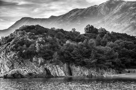 Montenegro mountainand sea landscape. Vacations summer background. Vintage black and white toned Stock Photo