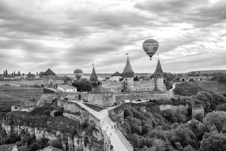 Kamyanets-Podilskyi, Ukraine - May 15, 2015: Festival Towards the sun sunset castle view Vintage black and white toned