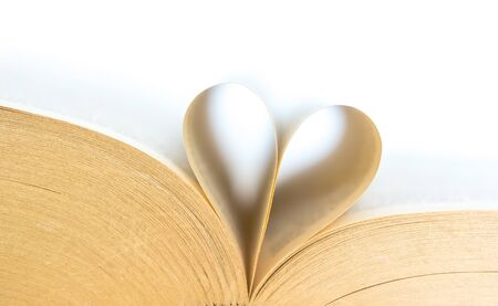 Book with opened pages of shape of heart isolated on white background. Love read concept. Knowledge symbol. Book day.