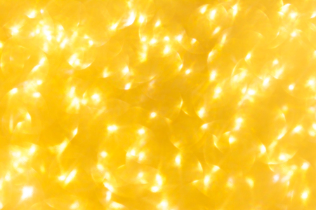 Gold bokeh blured background. Abstract sparkle glitter shiny holiday texture. Greeting card template. Copy space. Stock Photo