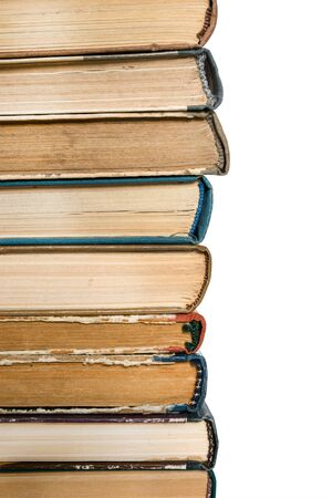 Stack of old books on the side on white isolated background. Love read concept. Knowledge symbol. Books day.